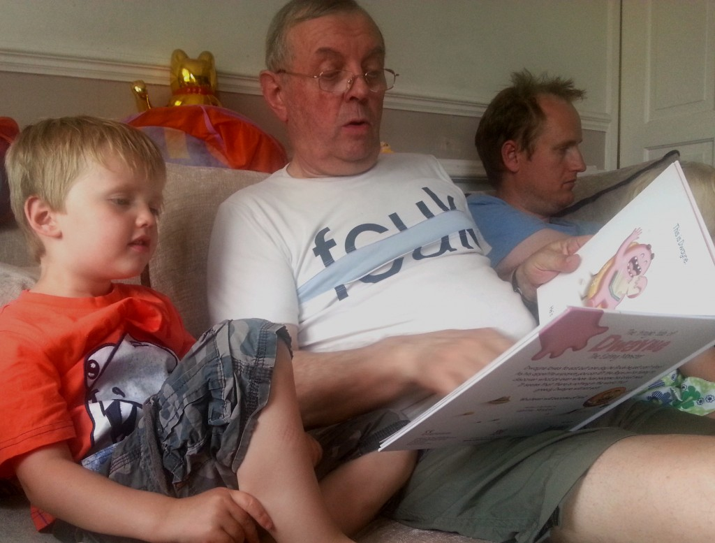 Wee Man enjoys the story with Grandad