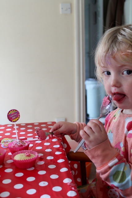 toddler eating icing fairy cakes