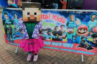 digital kids show sign with kid dressed as Steve Minecraft